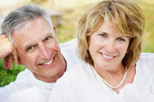 Older couple with beautiful dental implants in Rockwall, TX.
