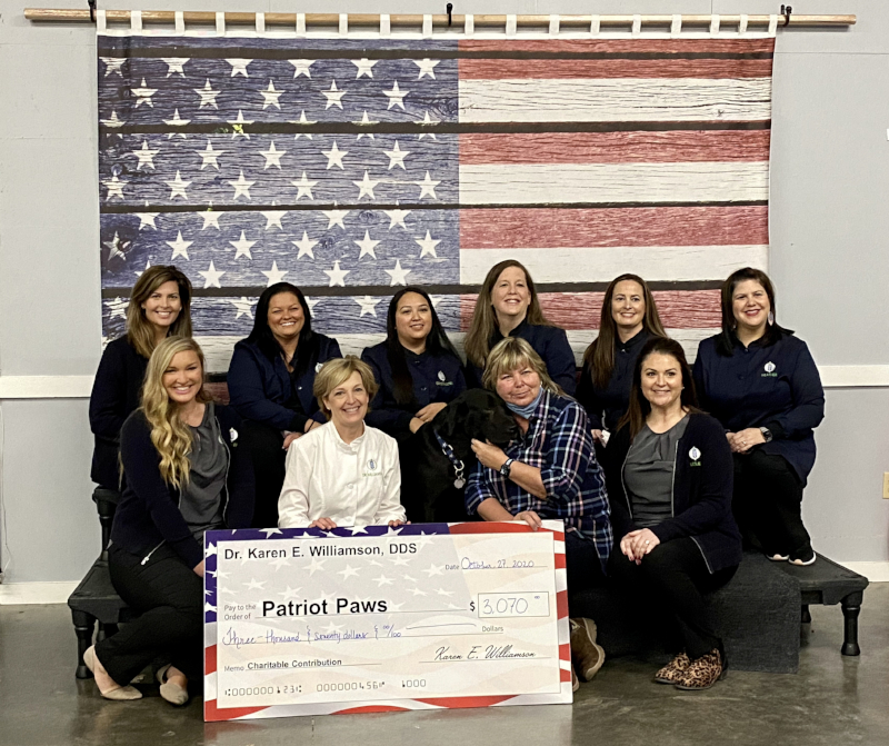 Dr. Williamson & team presenting 2020 annual fundraising donation to local patriot paws service dogs for veterans.